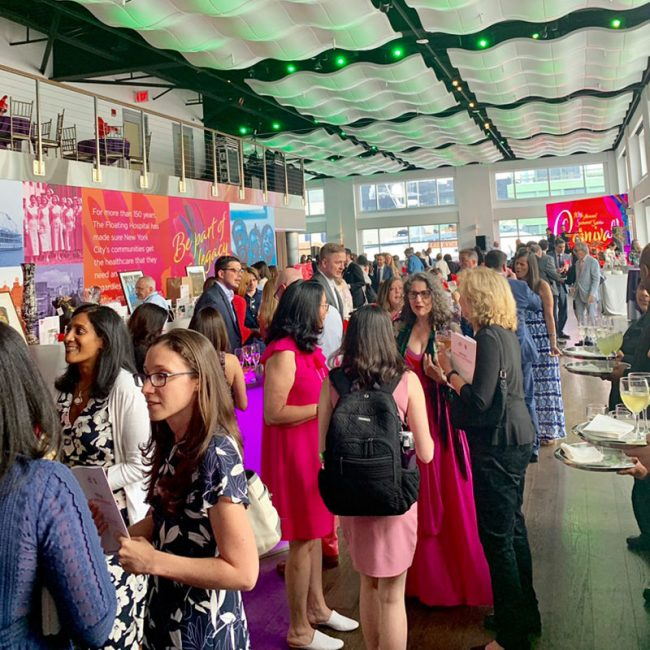 The Floating Hospital 2019 Summer Soiree during the event, showing the giant wall banner and video screen with the logo.